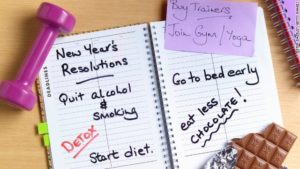 a notebook with new year's resolutions written
